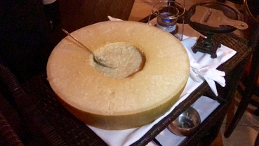 parmesan risotto inside a wheel of parmesan