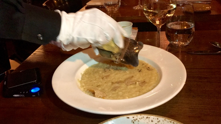 white truffle shaved over the risotto